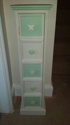 Upcycled CD unit. I couldn't find any knobs I really liked that I could afford. So I bought some cheap children's furniture knobs and chalk painted them 😀