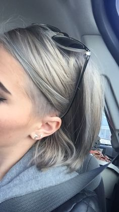 Grey hair with undercut, bob, angled short hair.