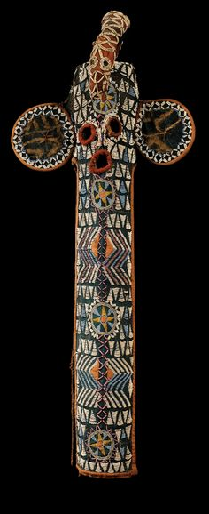 Africa   Elephant mask ~ 'tou-poum' ~ from the Bamiléké people of Cameroon   Raffia fiber textiles lined with black cloth, decorated with glass beads