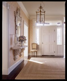 A marble shelf with carved brackets is the perfect fit for this formal entry.