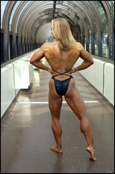 Female Bodybuilder Amanda Dunbar posing her muscled physique and awesome calves for WPWMAX!