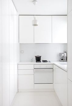Small square kitchen layout- all white - concealed rangehood - approx 2150 across