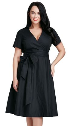 This incredibly gorgeous plus size black surplice midi dress is a superb alternative to your usual LBD.