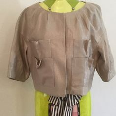 BCBGMaxAzria gold beige short jacket size L BCBG MaxAzria beige jacket that has gold threading so this jacket has a shimmery gold look.  Super comfy.  Size tag missing but is a large.  It's a shirt jacket, not fitted, hits at around waistline.  Sleeves are about 3/4 length.  Fully lined, excellent condition.  Perfect for night out or for dressing up a pair of jeans.  Lightweight, BCBGMaxAzria Jackets & Coats