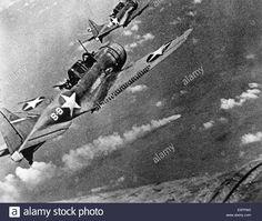 "BATTLE OF MIDWAY US Navy Douglas SBD-3 ""Dauntless"" dive bombers prepare to attack burning Japanese cruiser Mikuma 6 June 1942"