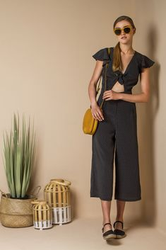 Tie front cropped jumpsuit in polka dot print.