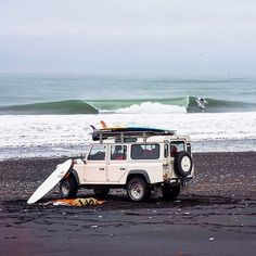 Everything - the Defender 110, the boards, the beach...