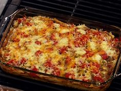 Cowboy Chicken Casserole from FoodNetwork.com - Chuck full of wonderful herbs & spices, white wine, fresh mushrooms, onions, peppers, chilies, tomatoes and cheese.