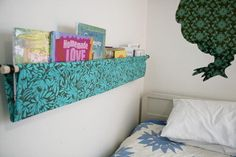 Hanging Fabric Bookshelves DIY- I thought I pinned this before, I went and bought all the supplies and then went to look at the pin and it wasn't there, I can't wait to put this together!