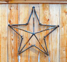 Decorative steel star handmade from steel bolts reclaimed from shipping pallets. This star measures 25 x 25 x 6 1/2 There is a washer welded at the top to help you hang your welded wishing star. You can display it outdoors on a fence or building--or you can mount it inside if you want to add industrial accents to your home. Each star is welded with care and skill by me. I take pride in making unique art and furniture from recycled or reclaimed materials. See my other listings for variations…