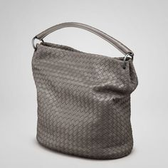 """Bottega Veneta Steel Intrecciato Nappa Bag style 255691 V0016 2873 Brilliantly designed, this nappa intrecciato bag is unstructured with a woven oval base, giving it enough shape to stand upright but also remain soft and malleable. With its small, single leather handle, the bag fits snugly under the arm. There is a hidden magnetic closure for security. The bag comes in two sizes. Interior zip pocket. Lining:Suede Dimensions:12.2"""" W x 13"""" H x 7.1"""" D"""