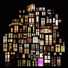 Photographer Anne-Laure House photographs illuminated windows at night in cities around the world, and arranges them into beautiful collages.(Amsterdam) http://www.mymodernmet.com/profiles/blogs/dreamy-window-collage-structures -- Collage by French artist Anne-Laure Maison manipulated