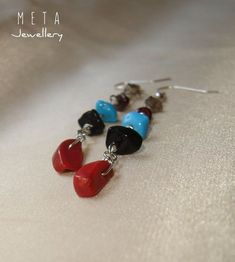 Natural stone rainbow color long earrings with smokey quartz, garnet, painted blue howlite, black obsidian and red coral chips. Total length is cm including silver plated ear wire Wire Earrings, Stone Earrings, Drop Earrings, Wire Wrapped Jewelry, Wire Jewelry, Unique Jewelry, Wire Work, Natural Stones, Chips