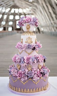 Beautiful lavender wedding cake. Create the gilded ornamentation with molds from www.sugarartmolds.com