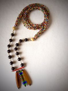 Micro glass beads, black wooden beads, glass beads (discs) + resin