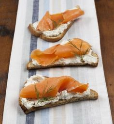 Rye Toast Triangles with Spreadable Goat Cheese, Smoked Salmon and Dill Sprigs