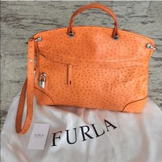 Gorgeous Furla Handbag Beautiful burnt orange color. Used 3 times. In perfect condition. Comes with dust bag. Not sure if I really want to sell but I'm thinking about it. Can be carried as a cross body or a tote carry. Very sophisticated style. Furla Bags Crossbody Bags