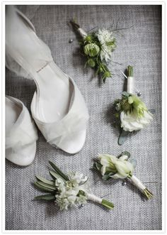 elegant white wedding shoes and simple boutonnieres