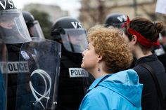It's like it's the 1910s all over again...  Peaceful women's rights protesters in Virginia stand up to riot police.
