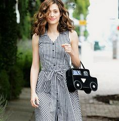 Emmy Rossum in a gingham dress and car-shaped handbag