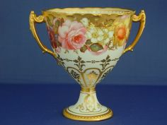 Royal Crown Derby Two Handled Goblet Decorated With An All Around Panel Of Flowers By Albert Gregory, Signed   c. 1901
