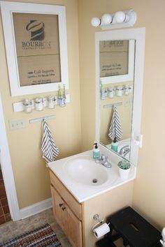 come see how I framed our bathroom mirror... and our bathroom before and after!