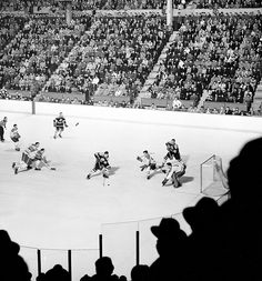 Aerial view of Montreal goalie Jacques Plante ready to make a save during a 1955 game between the Canadiens and Bruins at the Montreal Forum. (Hy Peskin/SI) POWER RANKINGS: Find out where the Bruins. Ice Hockey Teams, Hockey Games, Hockey Players, Men's Hockey, Montreal Canadiens, Nhl Winter Classic, Canada Hockey, Boston Bruins Hockey, Wayne Gretzky