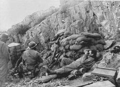 Forward Observers on Mount Porchia, south of Cassino. Note field phone to the right and sand-bagged observation post.