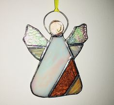 A beautiful angel made to hang as a suncatcher in shades of golden orange glass combined with a pearlescent white - all combined and soldered together to form the main body, a glass nugget is used for her face and tinned copper wire soldered on to form. Christmas Tree Decorations, Christmas Ornaments, Holiday Decor, Christmas Gifts, Modern Christmas, Christmas Time, Stained Glass Crafts, Christmas Angels, Suncatchers