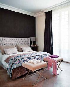 dark wall behind a light grey tufted head board. <3 <3 <3 the stools aren't too shabby, either.