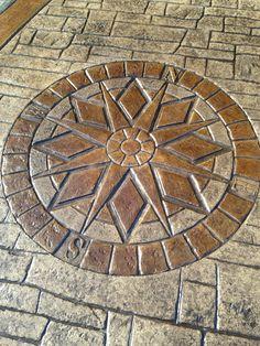 Stamp concrete compass from C Boesch masonry waretonw New Jersey