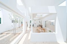 The living spaces and indoor-outdoor garden at House N by Sou Fujimoto.