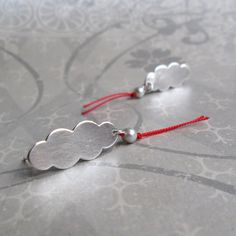 quenchmetalworks - EARRINGS sterling silver oval smoke plumes with pearls and red silk thread.