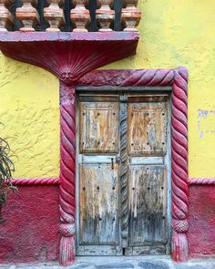 My favorite detail of this doorway is the face in the upper left corner, mustache and all. This door is always watching