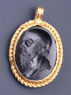Roman  Pendant with an intaglio portrait of Socrates, 2nd century A.D.  Black jasper and gold