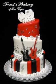 """""""I wanna Rock N Roll all night and party everyday.."""" Enjoy this 3 layer cake and rock out with your family and friends. Simple black white and red themed color cake. Notice the music notes, the dices and most of all, the red and black guitars! Such a creative and innovative design for a person who loves rock n roll! by florence"""