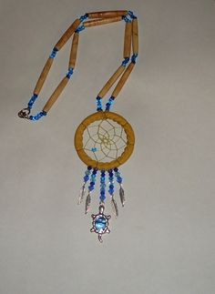 bone and bead dream catcher necklace, made by Emilie Corbiere.