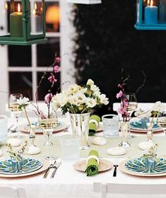 "beautiful table setting - ""Fill tiny tin cups with fresh-cut blooms and place at each setting for sweet-smelling ambience.""  -Real Simple"