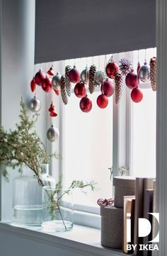 In a window, the bottom of a white curtain is decorated with IKEA DECO ornaments Christmas Hearts, Noel Christmas, All Things Christmas, Winter Christmas, Christmas Wreaths, Outdoor Christmas, Homemade Christmas, Winter Holidays, Christmas Baubles
