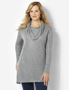 Cozy cowlneck sweater is extra long for pairing with leggings and boots. Solid tunic shimmers with metallic lurex yarn along the colorful, space-dye fabric. Complete with an asymmetrical hem with slits on each side. Catherines tops are perfectly proportioned for the plus size woman. catherines.com