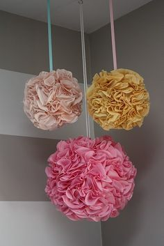 DIY Pom Poms made with fabric. Oh my goodness I'm so excited to do this! These are so pretty!