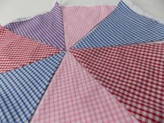 2 Metres of Rainbow Gingham Bunting Red, Purple, Pink and Blue Gingham Material All flags are double sided so you can hang your bunting any way you wish Made with love and care by Miss Stitchies <3