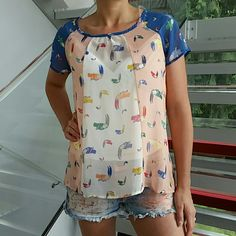 """Playful Toucan Top NWOT Brand new no tags  Playful toucan top with block colors of blue, peach and cream. Pair with you favorite jeans and sandals or classy slacks and heels. This top is perfect for spring/summer!!!  Size small Length approx 23""""  Bust approx 20"""" side to side Material is 100% polyester Multi colored toucans Sheer material, you can wear a tank top underneath ( I wore my own tank top, no included) Tops Blouses"""