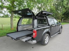 The Avenger Professional is the ultimate in the working/commercial canopy whilst still offering gently curving lines that compliment your pick-up. This canopy is hugely recognised and used by major fleets such as the NHS, Fire Brigade and many others. Truck Tent, Truck Camping, Nissan Navara D40, Truck Camper Shells, Truck Bed Storage, Truck Caps, Kombi Home, Truck Accessories, Roof Rack