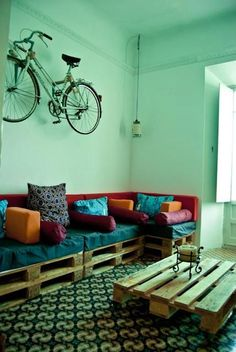 Hanging bike and palet sofa and table. Lamps made with cristal pots and chinese newspaper. At Itinere School and Hostel in Granada. info@itinereschool.com: