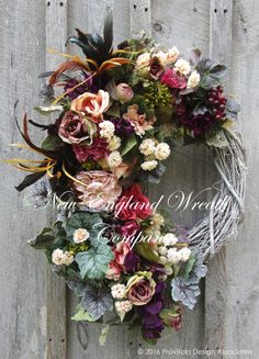 Tuscany Romance Garden Wreath. A magnificent collection of lush Roses, Wisteria, Peonies, Hydrangea and Mums in delicate blush, creamy ivory, salmon, plum and opulent purples mingle with wildflowers,