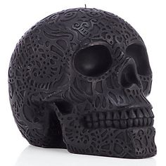 This jet-black, carved matte skull candle will set your house aflame with a spooky glow. Makes the perfect center piece for any Halloween fete or Day of the Dead celebration!