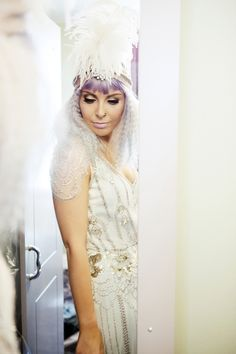 Pretty pastel wedding with a bride rocking a Jenny Packham wedding dress, lilac hair & a statement turban feather head piece