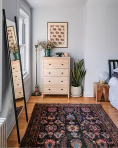 Opt for vintage rugs and green thumb touches a la @roomsauce's boho babe bedroom details | Shop this pic instantly from your phone and…