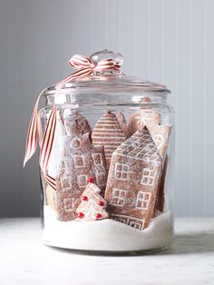 This snowy gingerbread city makes a stunning holiday centerpiece. We& sharing one of our favorite gingerbread house ideas including a free printable template. It& an easy Christmas decoration the kids can help make. Gingerbread Village, Christmas Gingerbread, Noel Christmas, Christmas Goodies, Christmas Treats, Simple Christmas, Winter Christmas, Gingerbread Cookies, Outdoor Christmas